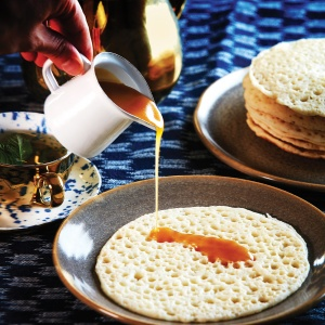 Baghrir: Moroccan semolina pancake with honey syrup